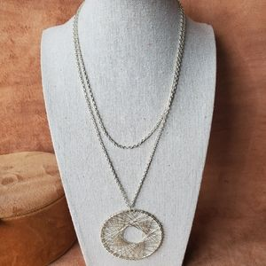 Long silver chain and dreamcatcher necklace